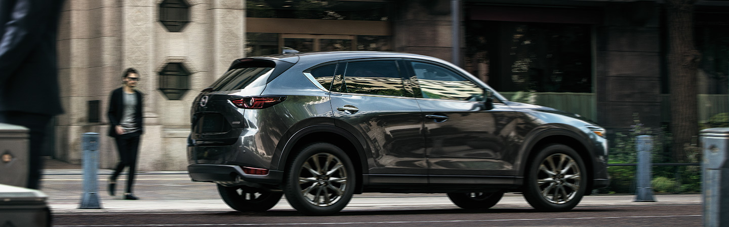 2019 Mazda CX-5, available at our Naples dealership, parked near Fort Myers, FL