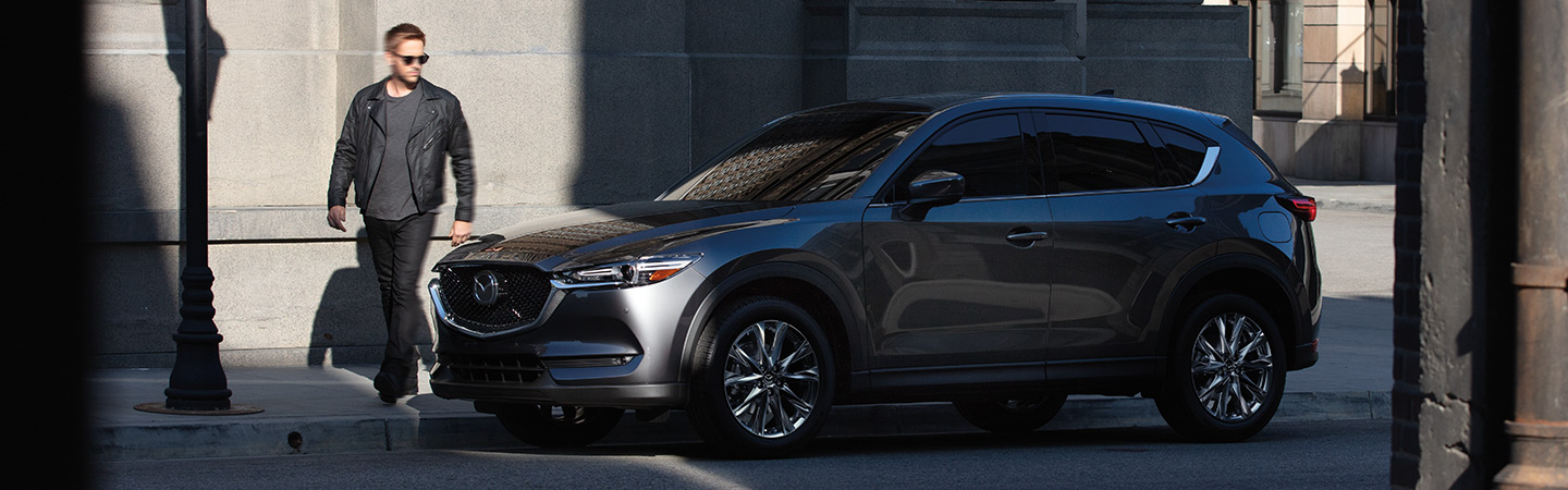 Side profile of the 2019 Mazda CX-5 parked, available at Naples Mazda