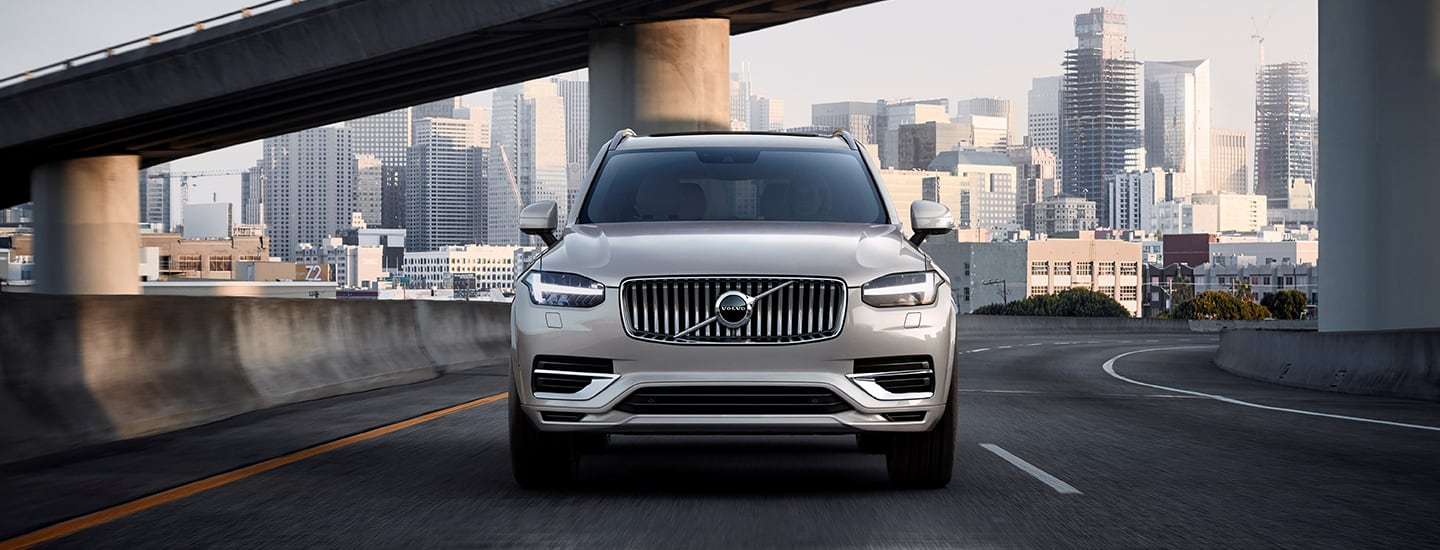 Front view of the 2021 Volvo XC90 driving out of the city