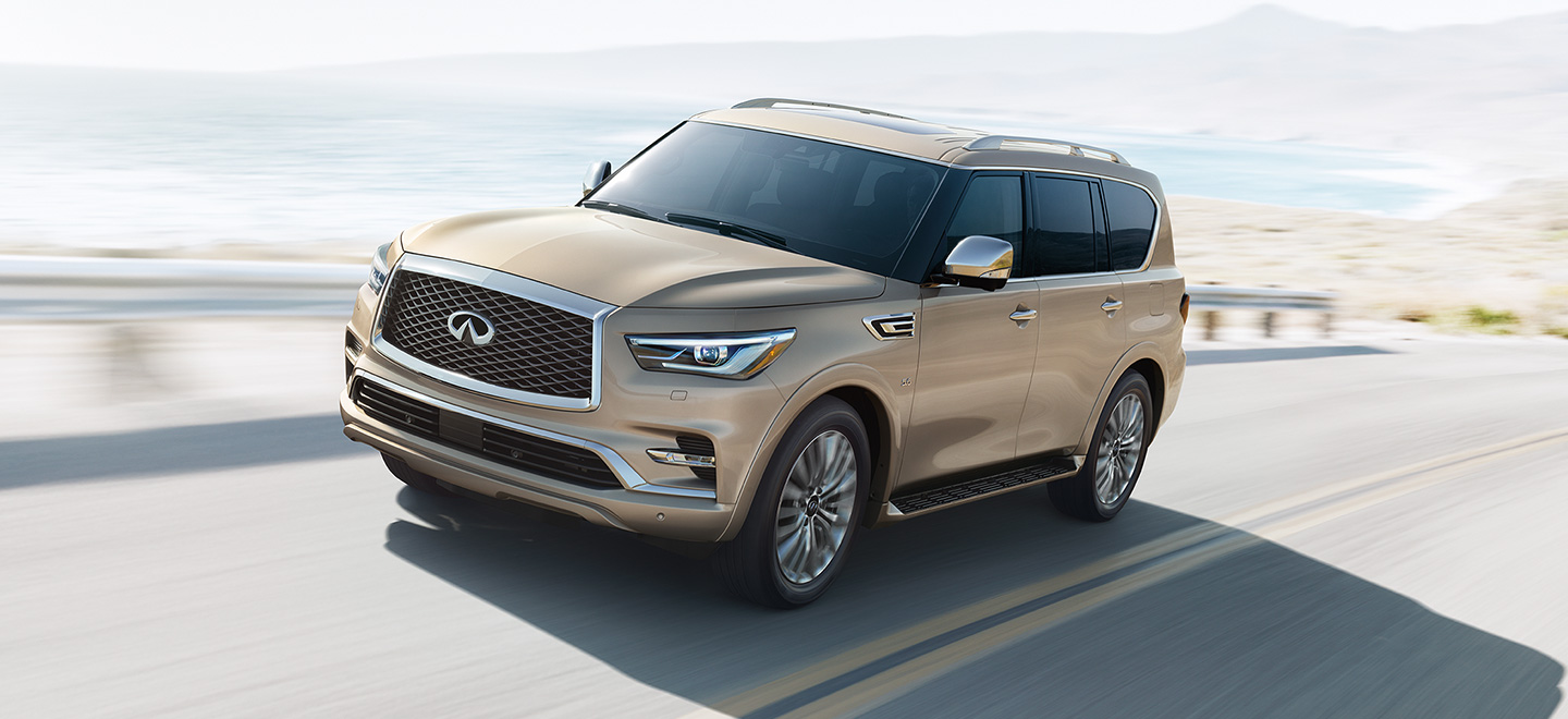 Image of a gold INFINITI QX80 for the Bob Moore INFINITI dealership in Oklahoma