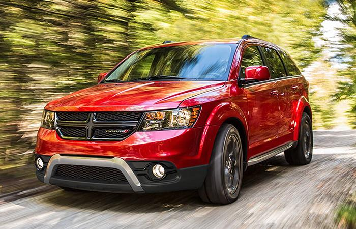 Red Dodge Journey in motion