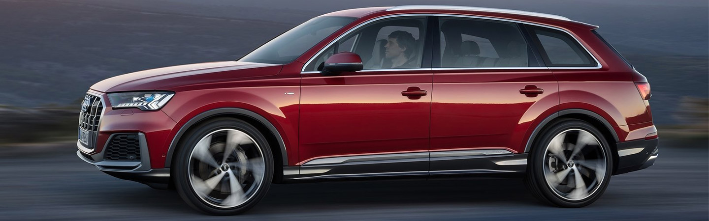 Red Audi Q7 in motion