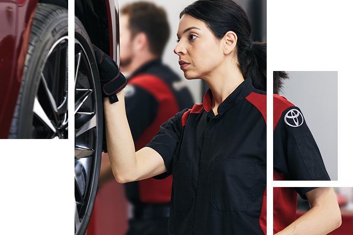 A technician checking a tire's tread