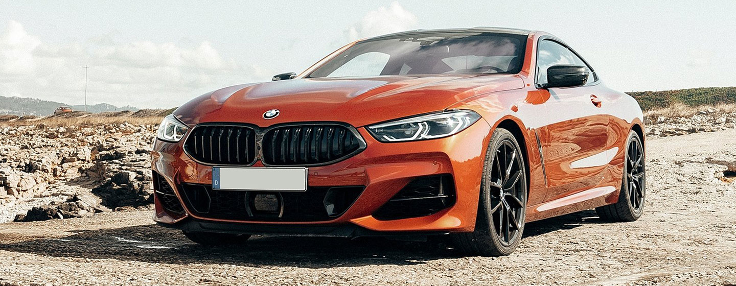 2019 BMW m850i exterior - parked in the gravel.