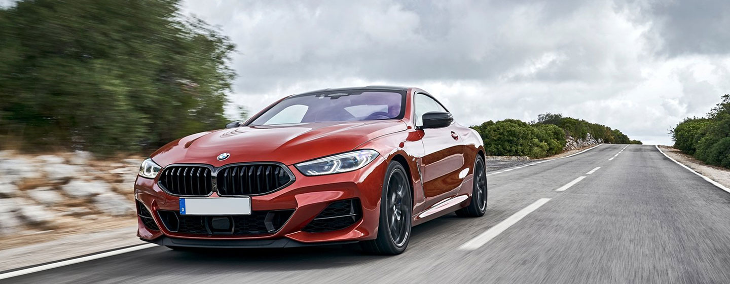 2019 BMW m850i exterior - driving on the road.