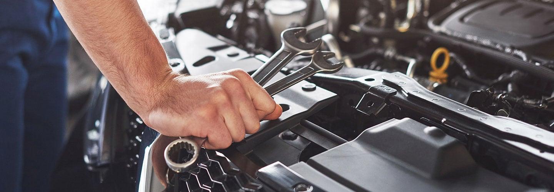 Technician installing auto parts