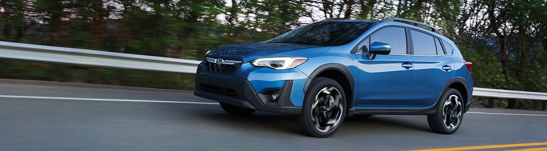 Blue Subaru Crosstrek Driving On Highway