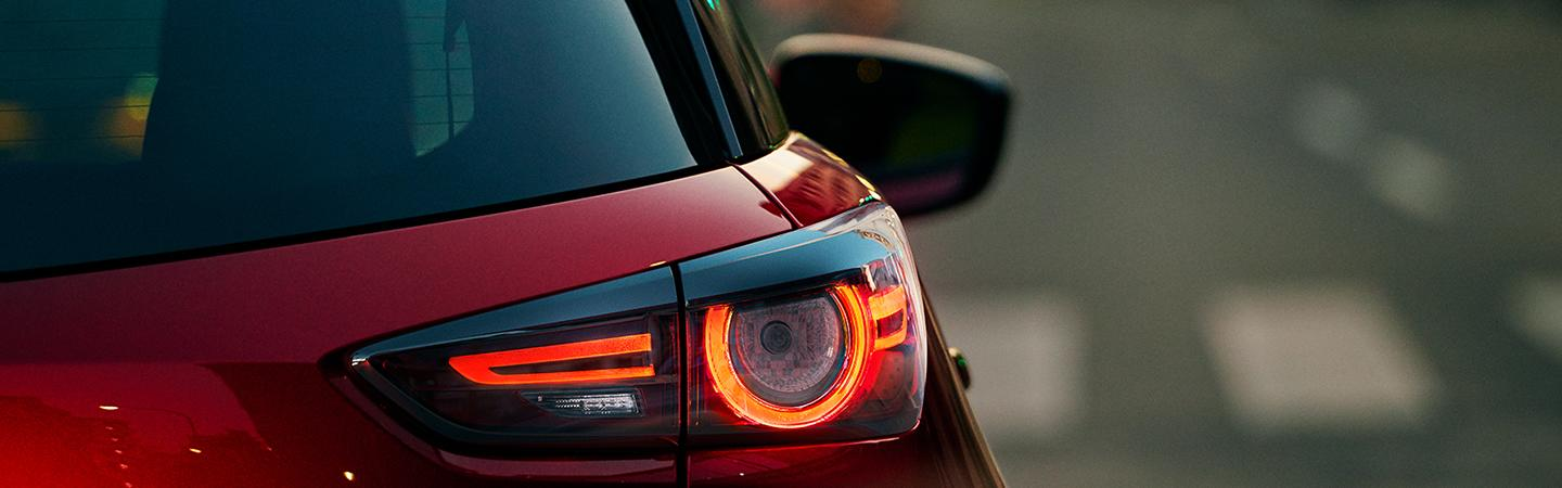 Close up view of a red Mazda CX-3's tail light