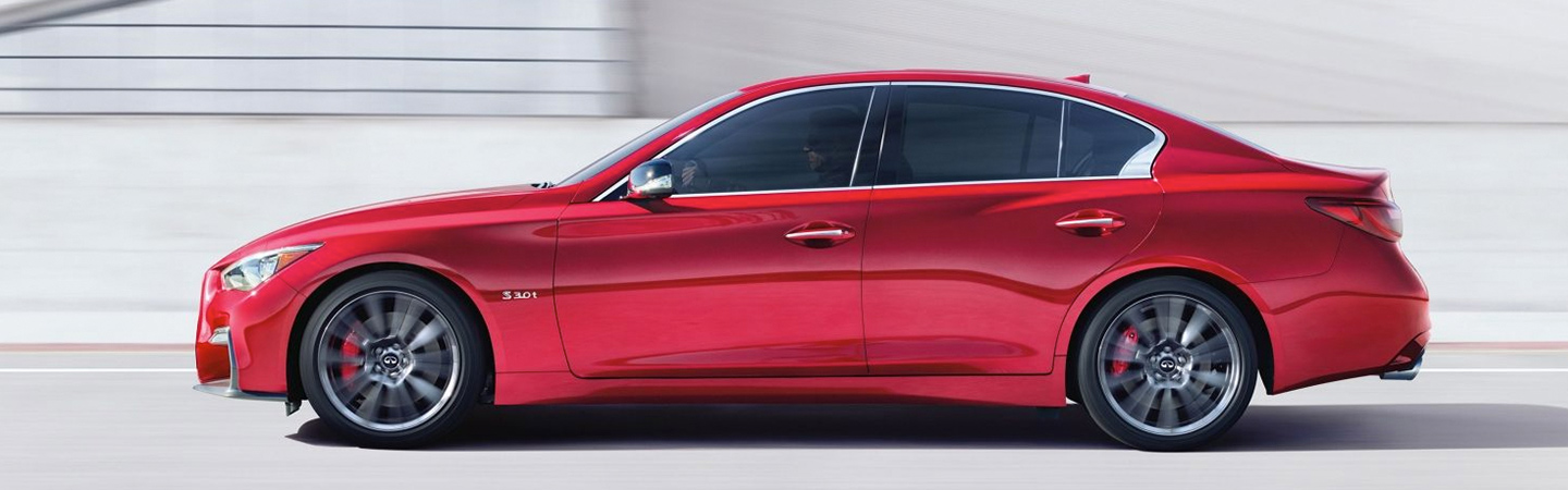 Side profile of the 2019 INFINITI Q50 in motion in Oklahoma City