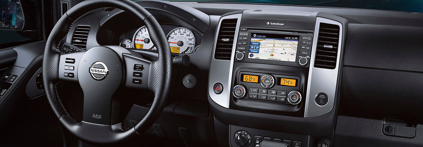 2019 Nissan Frontier steering wheel and infotainment center, available at our Nissan dealership.