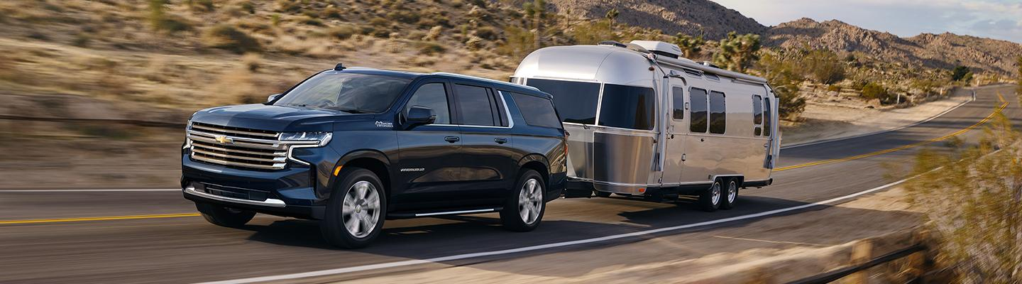 Angled profile of a Chevrolet Suburban towing a trailer
