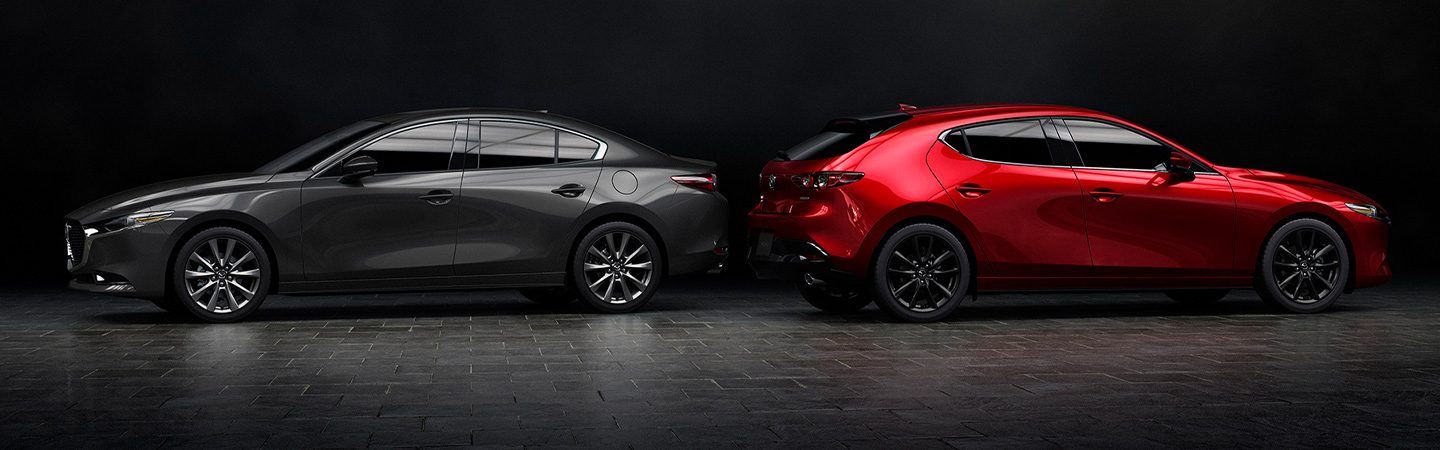 Two 2019 Mazda3 vehicles parked together