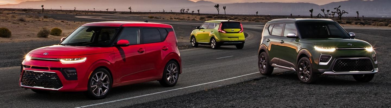 Three 2021 Kia Soul's parked on a desert road