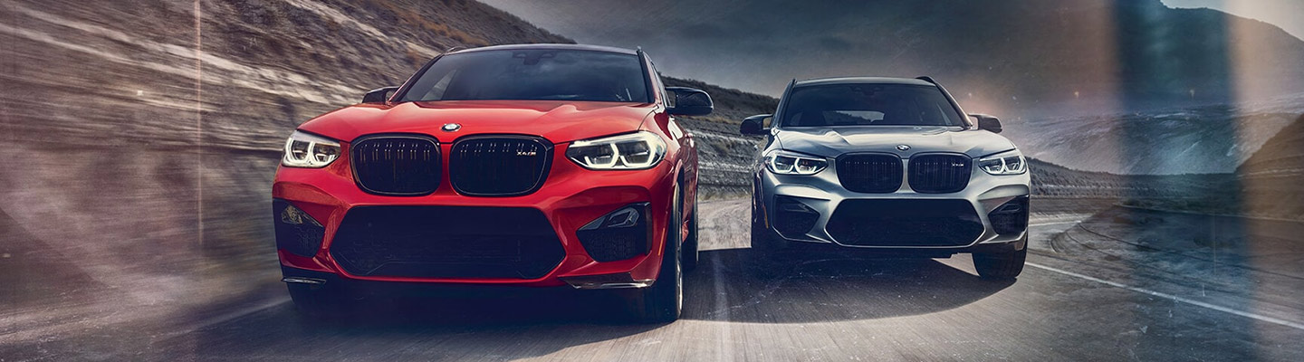 Two 2020 BMW X3 M vehicles in motion