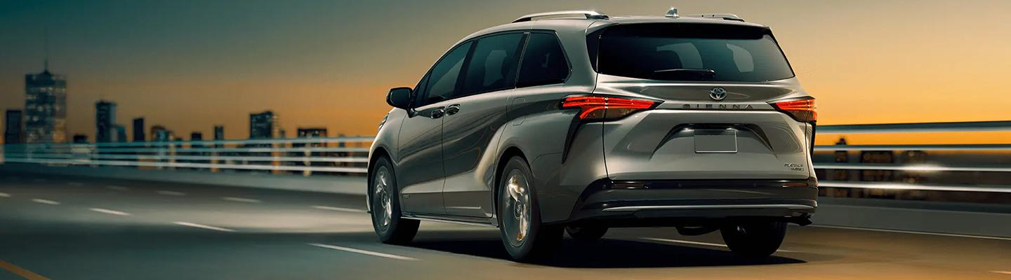 Rear view of the 2021 Toyota Sienna in motion