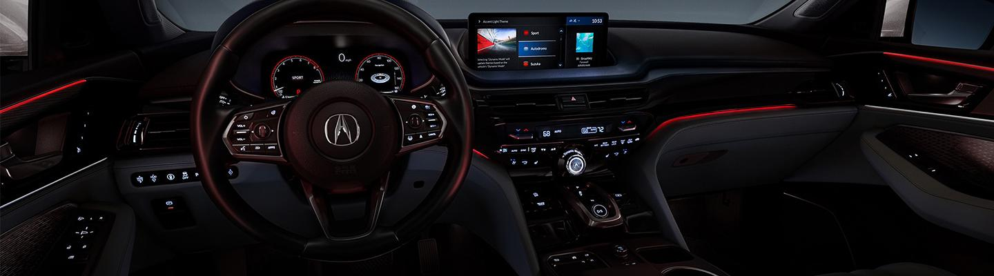 Close up view of the 2022 Acura MDX steering wheel and dashboard