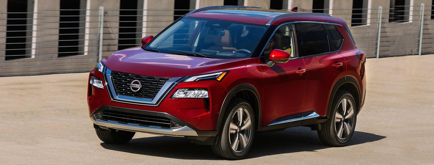 Red 2021 Nissan Rogue in motion