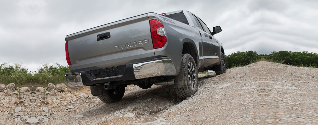 Rear view of a Tundra going up a hill