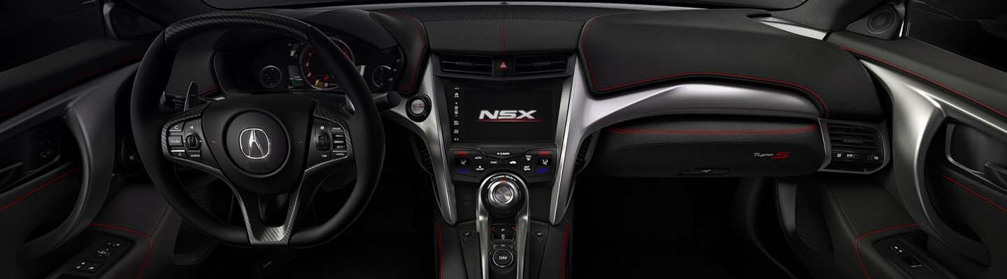 Interior view of an Acura NSX steering wheel and dashboard