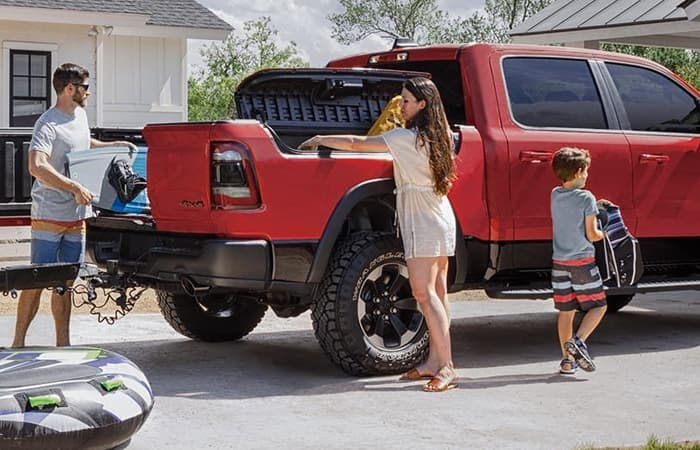 Exterior image with a family of the 2020 RAM 1500 for sale.