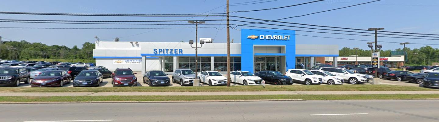 Exterior view of the Spitzer Chevy dealership in Amherst, OH