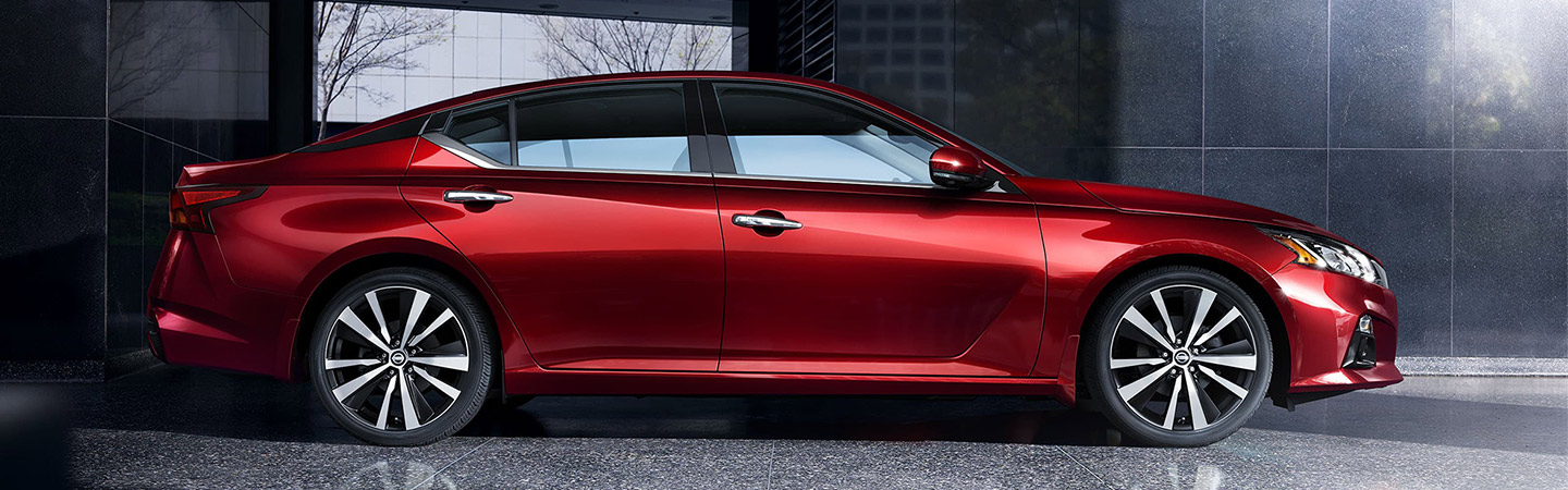 Right side profile of a red 2020 Nissan Altima
