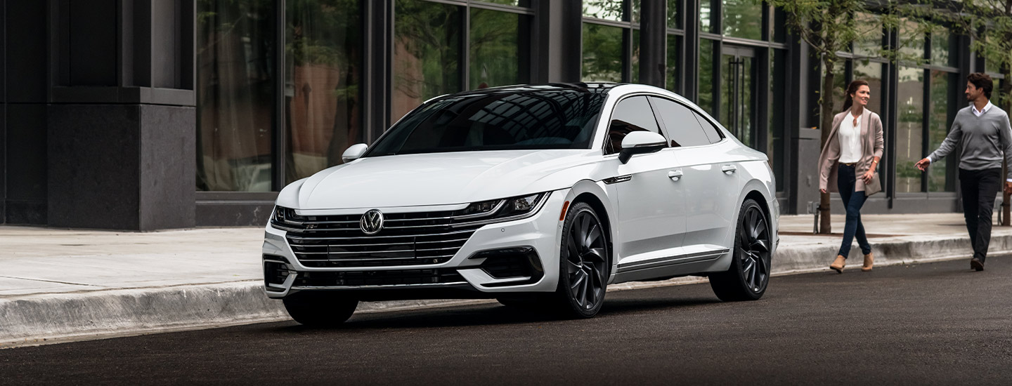 2019 Volkswagen Arteon - White - Parked next to a building