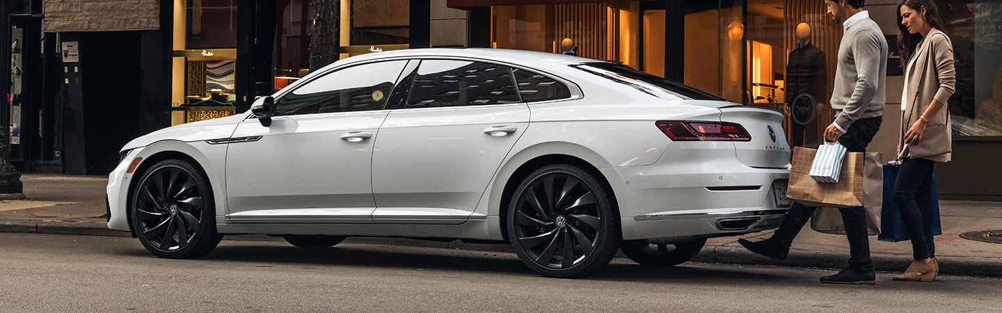 2019 Volkswagen Arteon - White - Side View - Parked next to a building