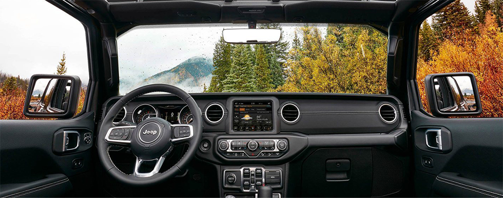 Safety features and interior of the 2018 Jeep Wrangler for sale at our dealership in Lake City, FL
