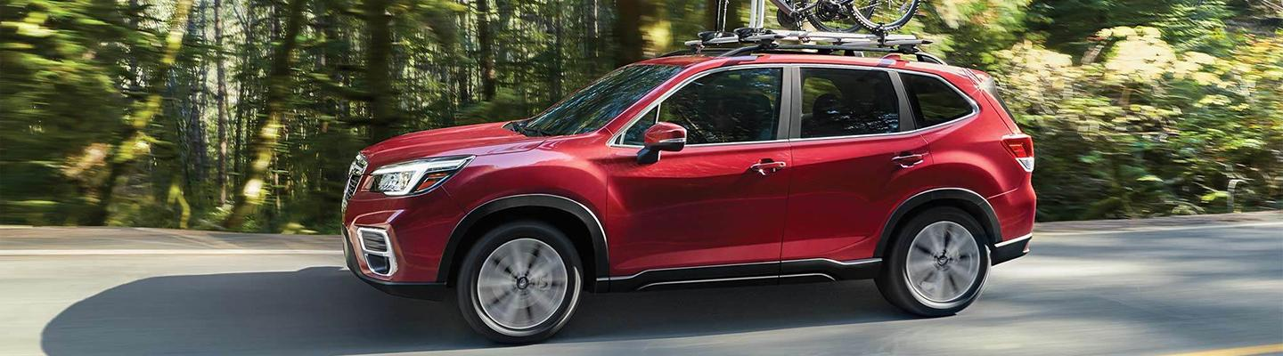 Red 2020 Subaru Forester in motion.