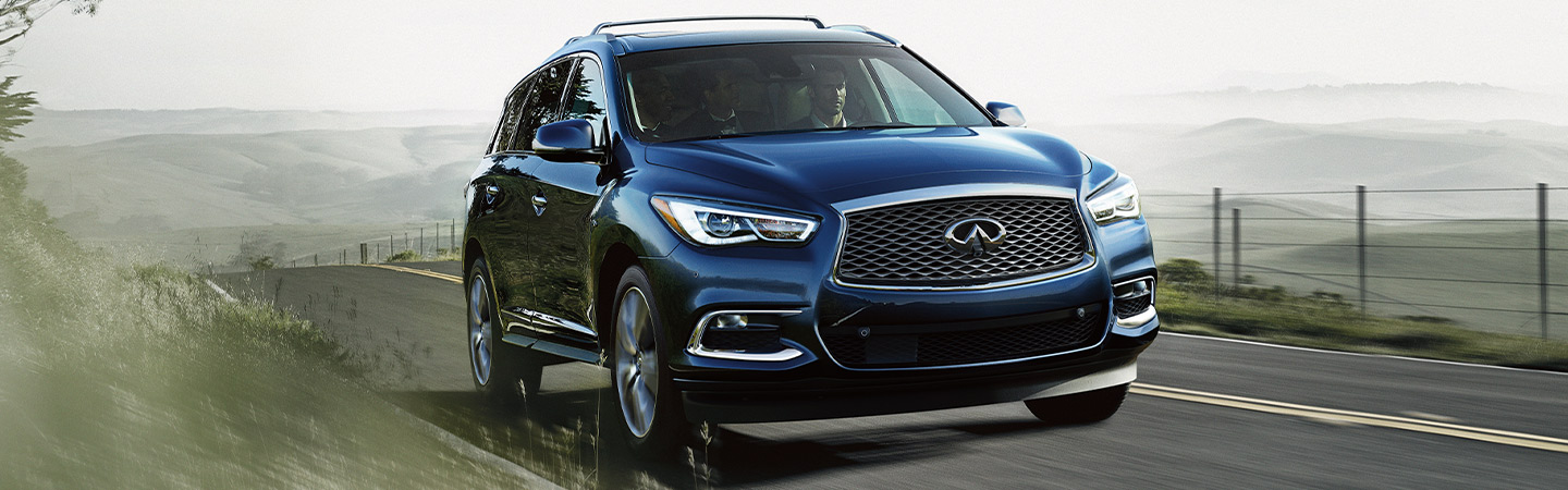 Front profile of the 2020 INFINITI QX60 driving in Oklahoma City, OK