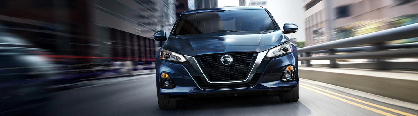 Front of the 2020 Nissan Altima in motion at Bob Moore Nissan in Oklahoma City, OK.