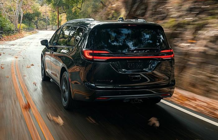 2021 Black Pacifica rear view in motion through a mountain road