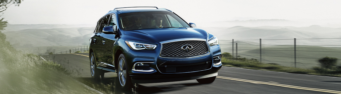 Side profile of the 2020 INFINITI QX60 in motion, available at Bob Moore INFINITI in Oklahoma City, OK