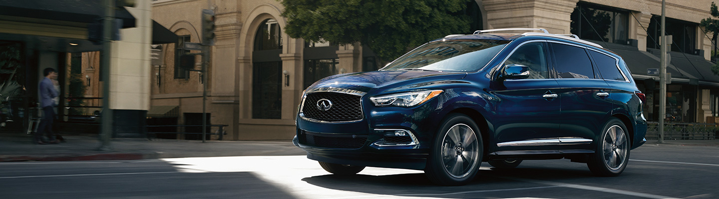 Side profile of the 2020 INFINITI QX60 in motion at Bob Moore INFINITI in Oklahoma City, OK.