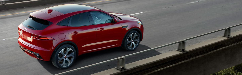 Jaguar E-Pace exterior driving on a bridge