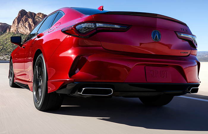 Rear view of the 2021 Acura TLX in motion