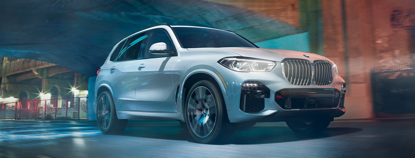 White 2020 BMW X5 in motion