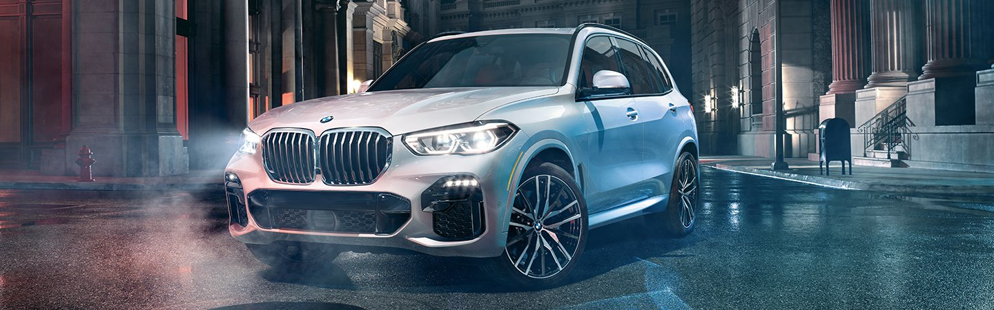 2020 BMW X5 turning on a city street