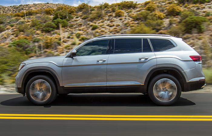 Driver side profile view of the 2021 VW Atlas in motion