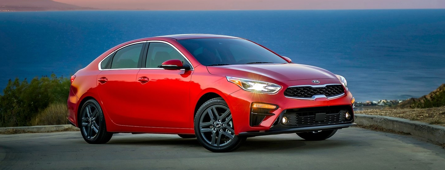 Red 2019 Kia Forte parked near the ocean