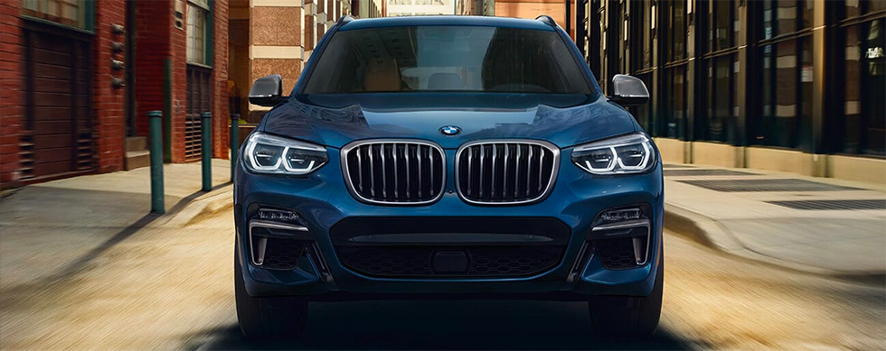 2019 BMW X3 Exterior - Front End - Driving on the road.