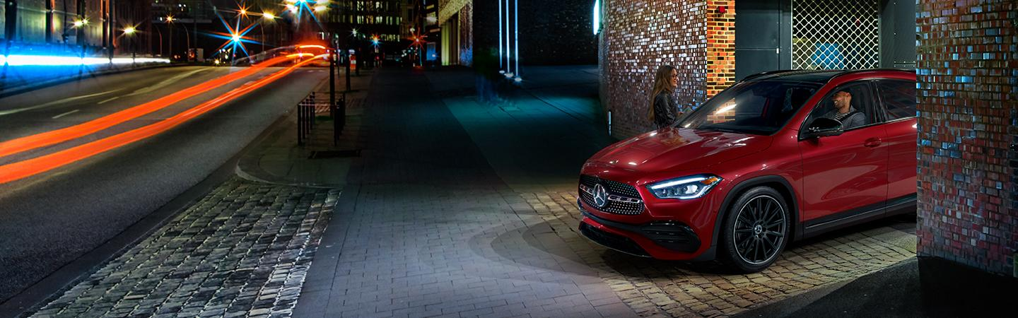 Red 2021 Mercedes-Benz GLA driving out of a garage