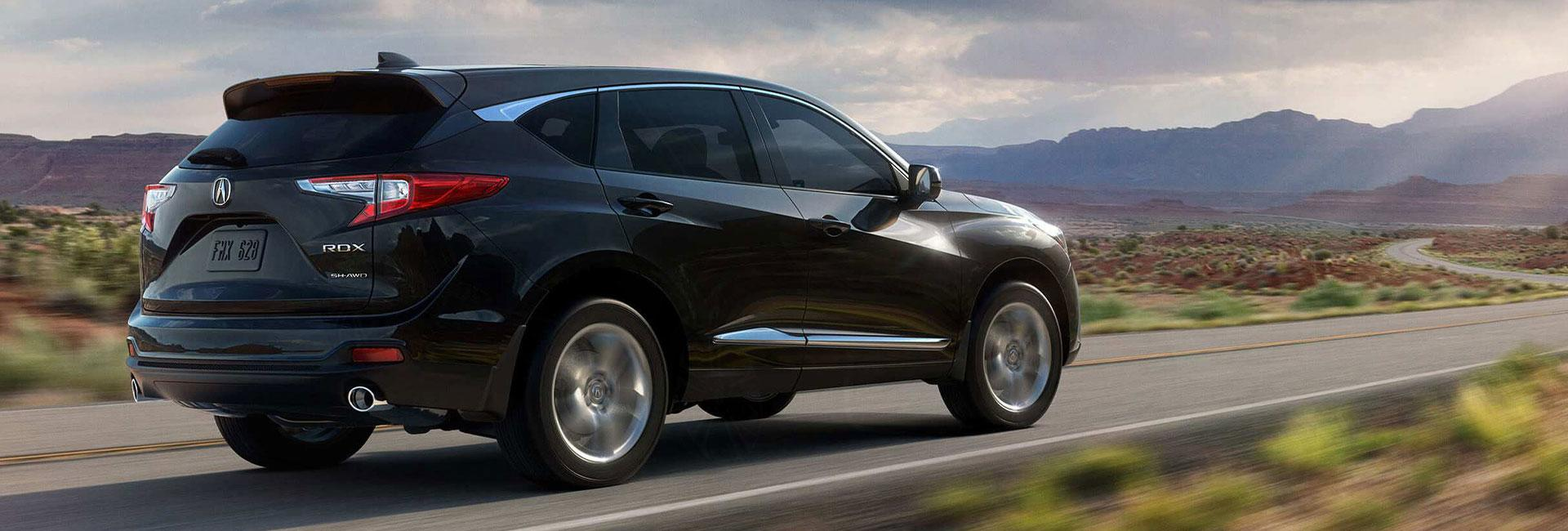 Black Acura RDX on a country road