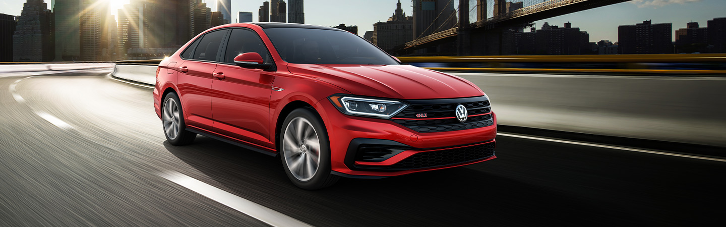 2019 Volkswagen Jetta GLI - Red - Side View - Driving on the road