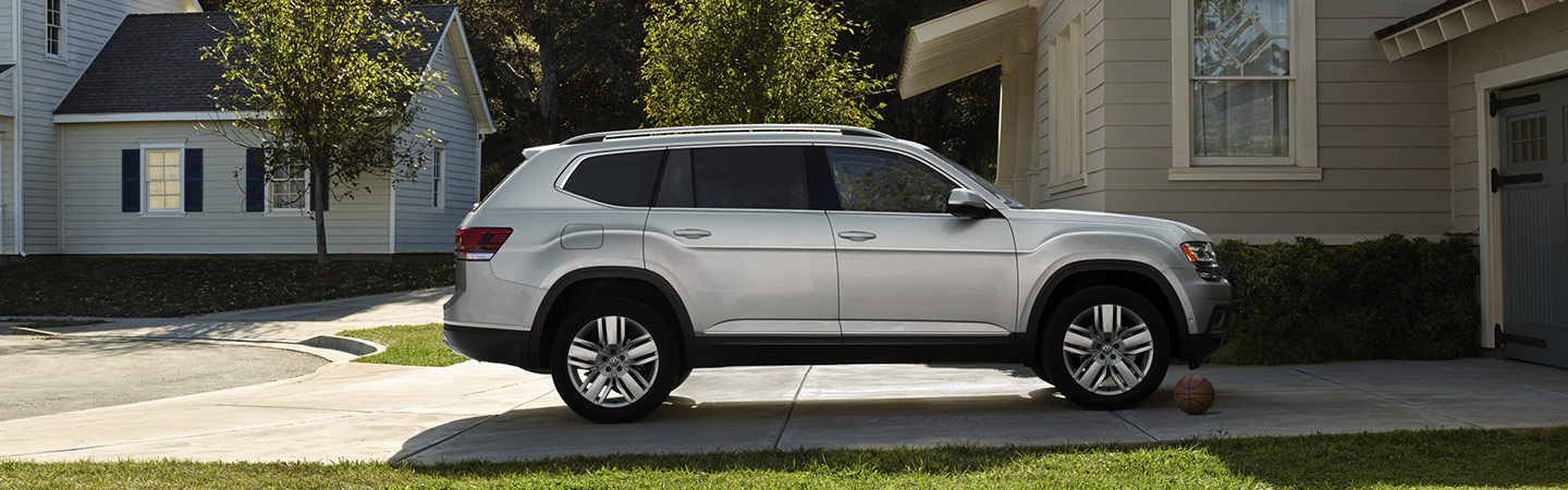 The 2019 Volkswagen Atlas parked outside a house