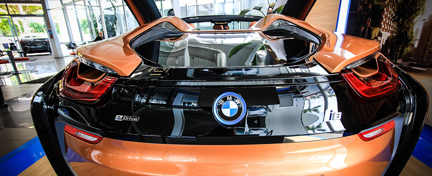 Back of BMW i8 Roadster with doors open at South BMW in Miami