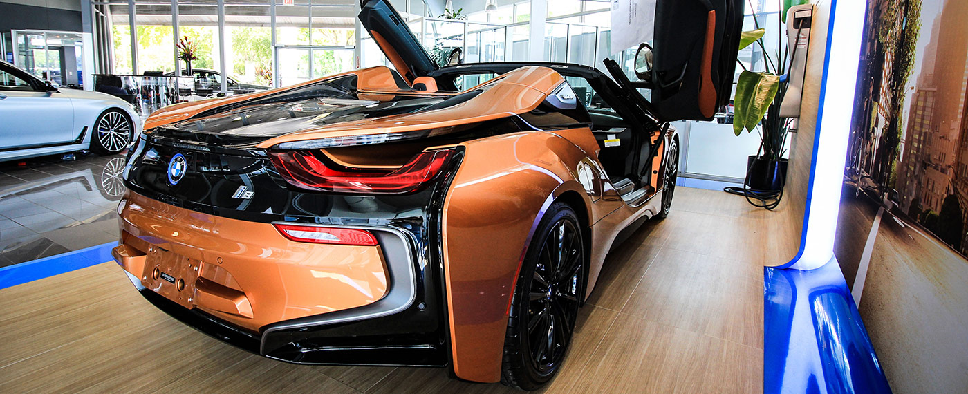 Back-right of BMW i8 Roadster with doors open at South Motors BMW in Miami