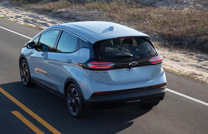 Rear angled profile of a Chevy Bolt in motion