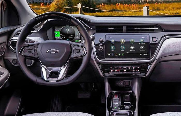 Close up view of a Chevy Bolt's steering wheel and dashboard